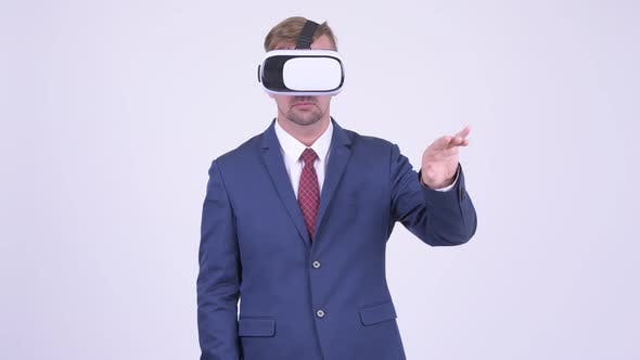 Thumbnail for Blonde Businessman Using Virtual Reality Headset