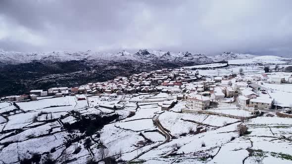 Winter in an Alpine Village. Snow on the Village Street