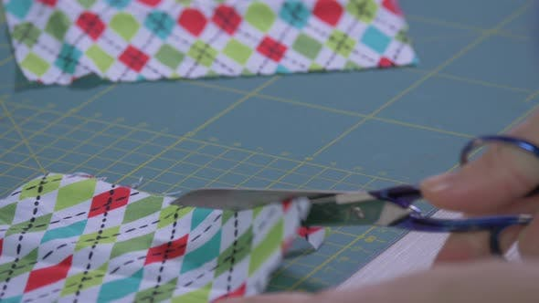 Thumbnail for Hand cutting a plaid fabric