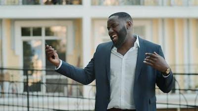 Smiling Afro Man Singing Urban Street