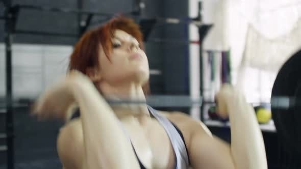 Thumbnail for Female Weightlifter Doing Overhead Press