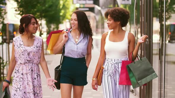 Cover Image for Happy Women with Shopping Bags Walking in City