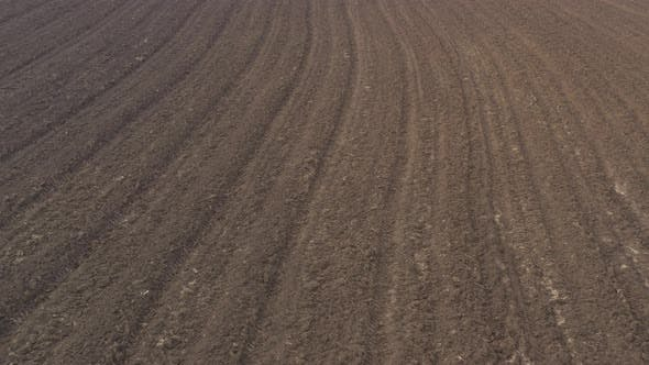 Thumbnail for Agricultural soil ready for spring works 4K aerial video
