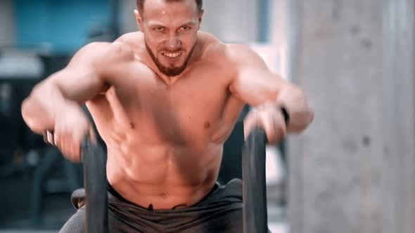 Thumbnail for An Attractive Man Bodybuilder Battling Ropes