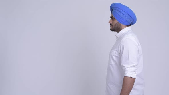 Profile View of Young Bearded Indian Sikh Man Thinking