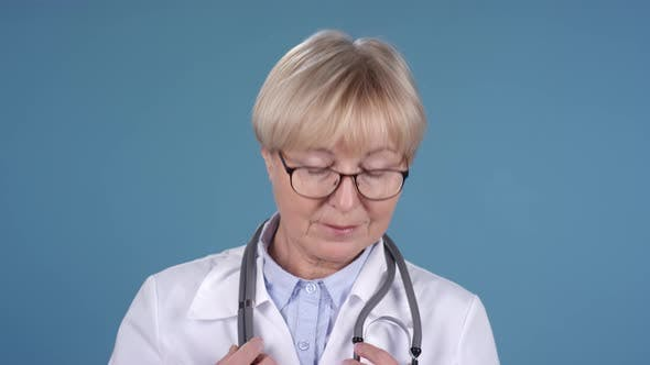 Thumbnail for Female Doctor Placing Stethoscope around Neck