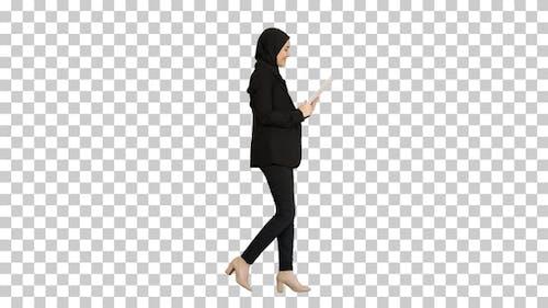 Cute Arabian businesswoman using tablet, Alpha Channel