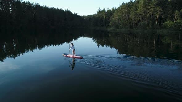 Thumbnail for Adventure Traveler Exploring Wild Nature Lake