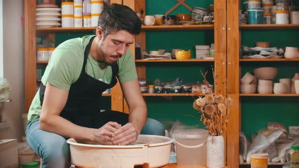 Thumbnail for Pottery - the Master Is Wetting His Hands in a Bucket of Water and Continuing To Work with Clay