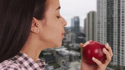 Mexican girl eating an apple in the big apple