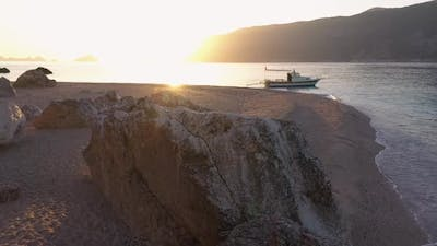 Boat on the Sea of Rocky Island at Sunset