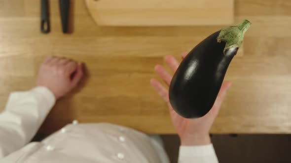 Thumbnail for Cook Throws Up Aubergine And Catches It