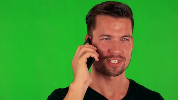 Thumbnail for Young Handsome Caucasian Man Phones with Smartphone - Green Screen - Closeup
