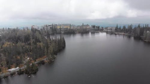Aerial View of Strbske Pleso, Slovakia. Mountain Lake in Clouds and Snowy Tatras Mountains