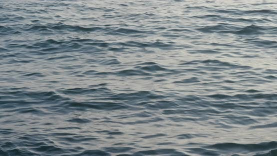 Thumbnail for Sea surface under sunset time
