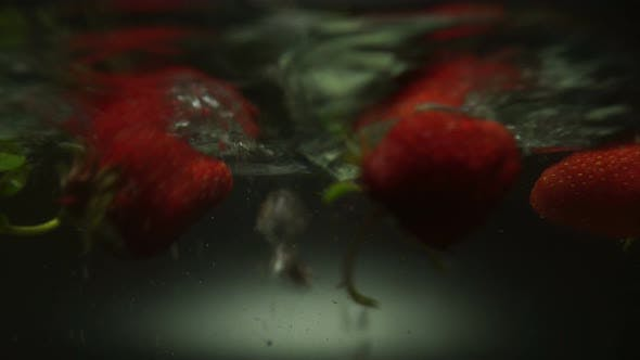 Cover Image for Ripe Strawberry Washes In Flowing Water