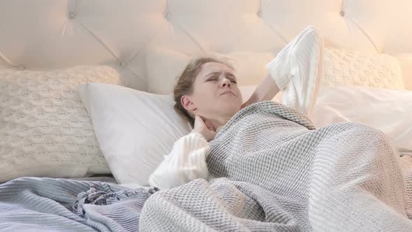 Thumbnail for Uncomfortable Sleeping Woman with Neck Pain in Bed