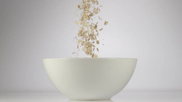 Thumbnail for Oat Flakes Falling In A Dish On A Table