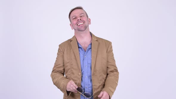 Cover Image for Happy Blonde Casual Businessman Laughing and Pointing Finger