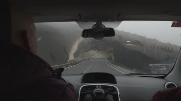 A Slowmotion View From a Windshield of a Car Moving Past the Volcanic Rock