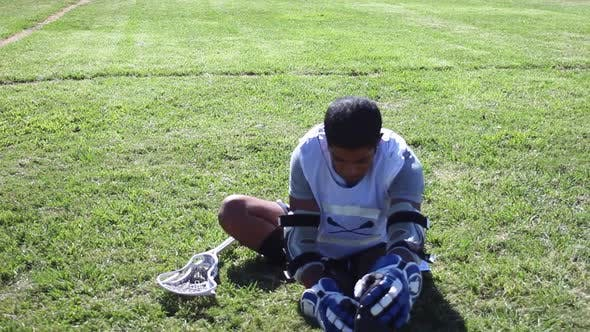 Thumbnail for A lacrosse player stretching and warming up.