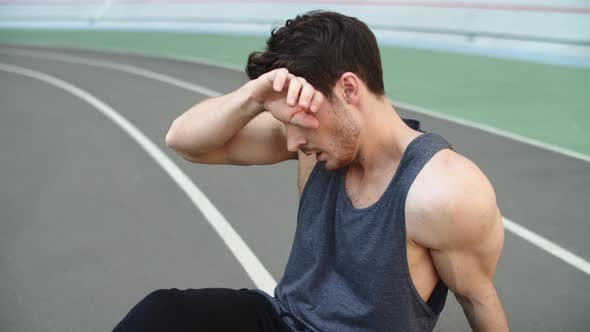 Thumbnail for Portrait of Tired Man Resting After Running Workout on Track. Exhausted Runner