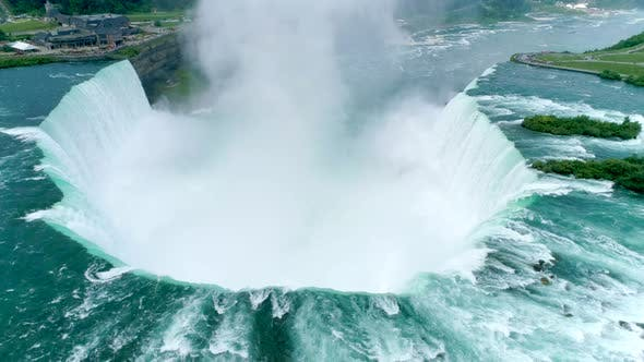 Thumbnail for The Mist and Spray From the Crashed Water Gets Higher Over the Horseshoe Falls