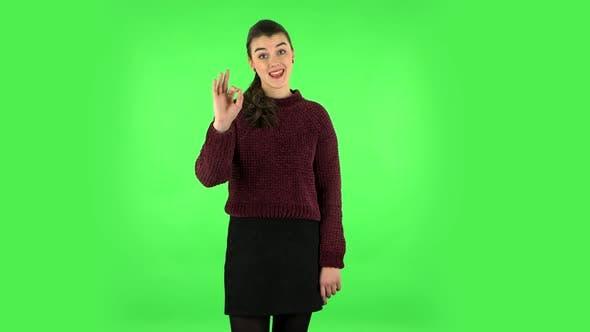 Thumbnail for Smiling Girl Makes Sign Ok. Green Screen