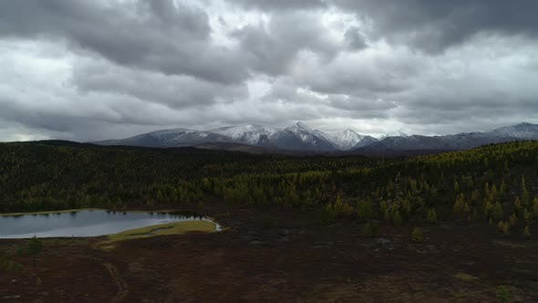 Thumbnail for High Panoramic Fly Drone Beautiful Snowy Mountains Peaks and Lake Wide Shot