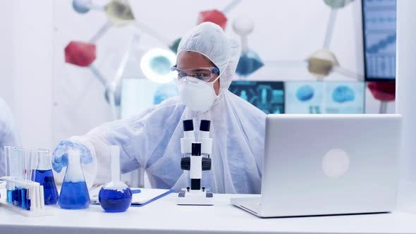 Female Scientist in Cover All Equipment Working in Chemistry Laboratory