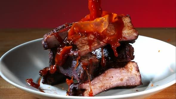 BBQ sauce pouring and splashing in ultra slow motion 1500fps onto BBQ ribs - BBQ PHANTOM