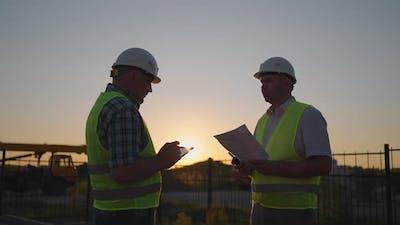 Portrait of Hands of Two Builders