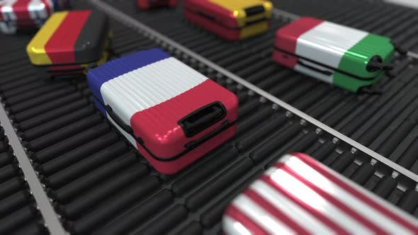 Thumbnail for Suitcases with State Flags Move on Conveyor