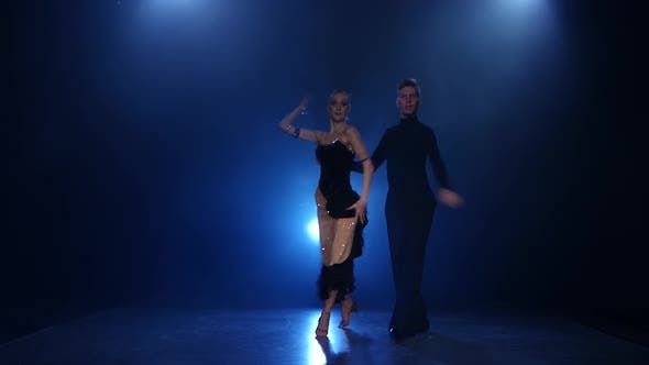 Thumbnail for Rumba Dancing Pair of Professional Elegant Dancers in Smoky Studio