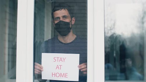 Man in Mask Asking To Stay at Home.
