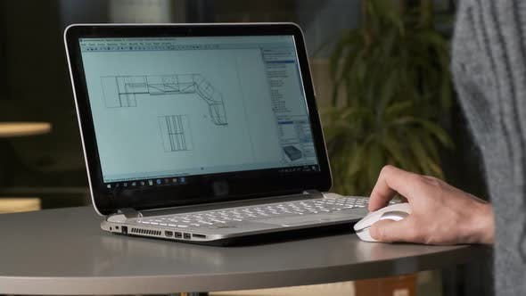 Thumbnail for Male Person Is Working on Architectural Designs Using a Laptop. Architect Working with Computer