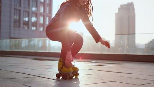 Roller Skater Doing Trick on Roof