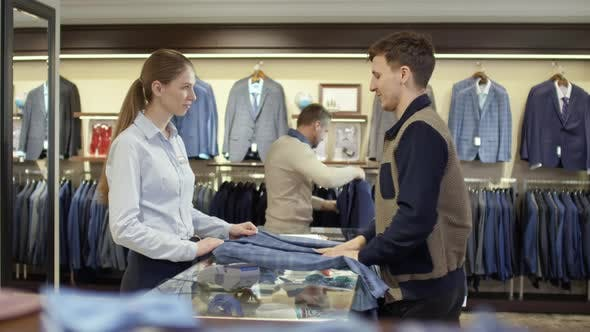 Thumbnail for Female Sales Assistant Working at Menswear Boutique