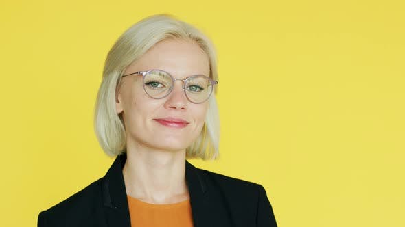 Thumbnail for Elegant Businesswoman in Glasses