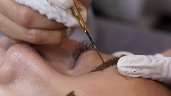 Permanent makeup with microblading brow on woman