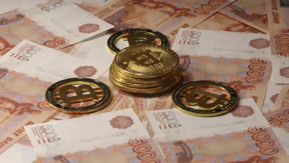Thumbnail for Bitcoin BTC Coins Rotating on Bills of 5000 Russian Rubles. Worldwide Virtual Internet