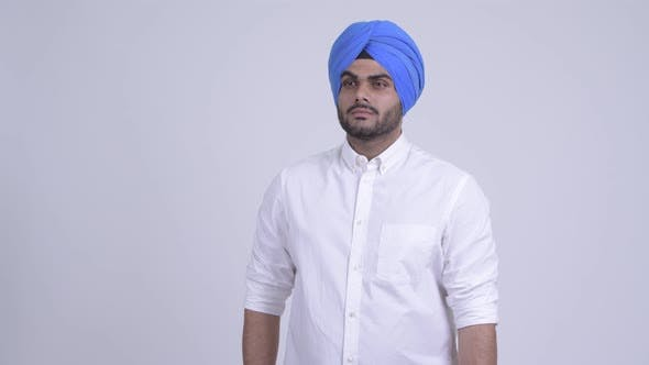 Thumbnail for Young Bearded Indian Sikh Man with Turban Thinking