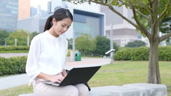 Thumbnail for Businesswoman use of notebook computer in city
