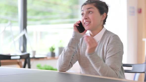 Thumbnail for Aggressive Indian Woman Talking on Smartphone