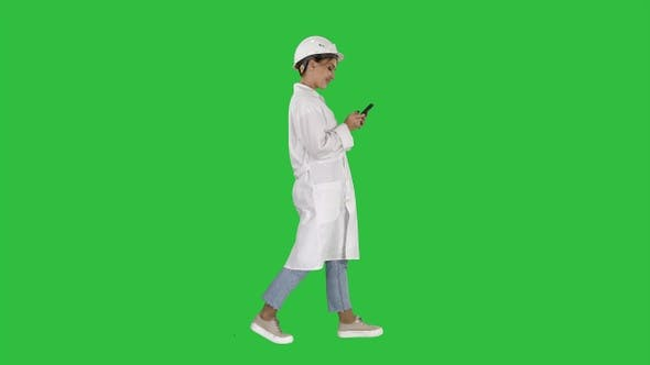 Thumbnail for Female Scientist Using Smartphone Walking on a Green Screen