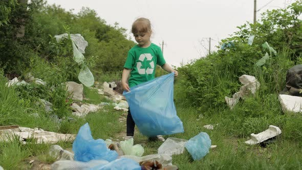 Thumbnail for Volunteer Girl Cleaning Up Dirty Park From Plastic Bags, Bottles. Reduce Trash Nature Pollution