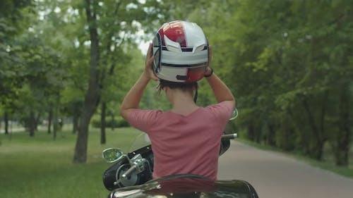 Pretty Blond Girl Enjoying Motorbike Ride Outdoor
