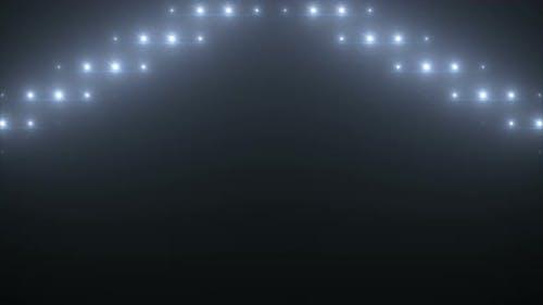 Bright stage lights flashing. White flashing lights wall