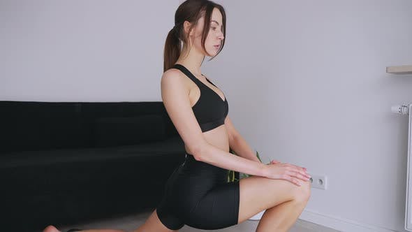 Calm Woman Stretching in Crescent Lunge Pose