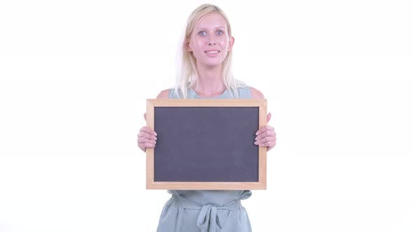 Thumbnail for Happy Young Blonde Woman Holding Blackboard and Getting Good News
